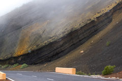 Highway road with line in Timanfaya, Lanzarote. Spain. Way to volcano Royalty Free Stock Photo