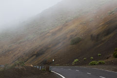 Highway road with line in Timanfaya, Lanzarote. Spain. Way to volcano Stock Photography