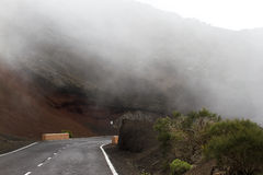 Highway road with line in Timanfaya, Lanzarote. Spain. Way to volcano Stock Image