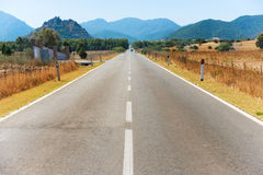 Highway road with mountains on horizon Stock Photo