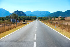 Highway road with mountains on horizon Stock Image