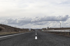 Highway road. Without traffic in daylight with cloudy sky Royalty Free Stock Image
