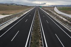 Highway road. Without traffic in daylight with cloudy sky Stock Photo