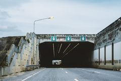 Highway road tunnel with 3 lane and 5.25 meter height limit road sign royalty free stock photo