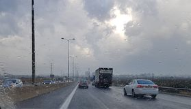 Rainy weather on the highway-traffic viewed through a car window. Highway Road view through car window blurry with heavy rain, Concept of driving in rain, bad Royalty Free Stock Photography