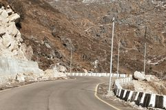 Highway road view of India China border near Nathu La mountain pass in Himalayas which connects Indian state Sikkim with China`s. Tibet Region, trisection point royalty free stock images