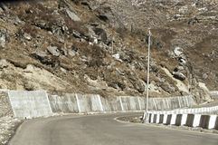 Highway road view of India China border near Nathu La mountain pass in Himalayas which connects Indian state Sikkim with China`s stock image