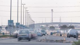 Highway roads with traffic timelapse in a big city from Ajman to Dubai before sunset. Transportation concept. Highway roads in desert with traffic timelapse in stock photo