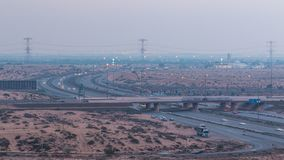 Highway roads with traffic day to night timelapse in a big city from Ajman to Dubai before sunset. Transportation concept. royalty free stock images