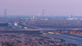 Highway roads with traffic day to night timelapse in a big city from Ajman to Dubai before sunset. Transportation. Highway roads in desert with traffic day to stock footage