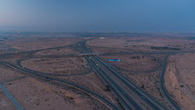 Highway roads with traffic night to day timelapse in a big city from Ajman to Dubai before sunrise. Transportation. Highway roads in desert with traffic night to stock video footage