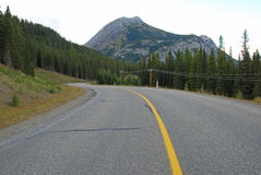 Highway in Rockies Stock Photography
