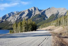 Highway in Rockies. Rough highway in Canadian Rockies at Kananaskis Country Alberta Canada royalty free stock photo