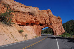 Highway through the rocks. A quiet stretch of highway, cutting through some red rocks in California, USA Stock Photos