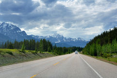 Highway in Rocky Mountains Stock Photo
