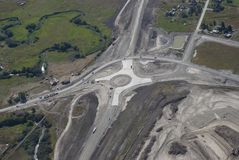 Highway roundabout intersection. Aerial view of highway roundabout under construction in Western Montana USA Stock Photos