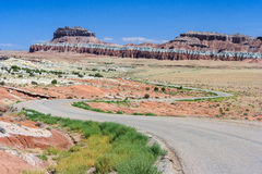 Highway running through colorful painted desert in central Utah near Canyonland Zion Bryce and Goblin Valley Royalty Free Stock Image