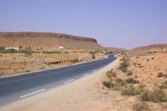 Highway through Sahara desert Royalty Free Stock Images