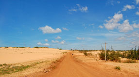 Highway with sand hill in Phan Thiet, Vietnam Stock Photos