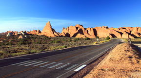 HIghway in a Sandstone Desert Royalty Free Stock Images