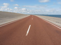 Highway on sandy coastline Stock Photos