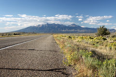Highway Scenery. View of mountain range from roadside of rural highway in desert landscape royalty free stock images