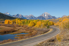 Highway Through the Scenic Tetons in Fall Royalty Free Stock Photo