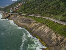 Highway by the sea. Wonderful road and bike path. Bicycle and road track and next to the blue sea in the city of Rio de Janeiro. Tim Maia bike path on Niemeyer stock images
