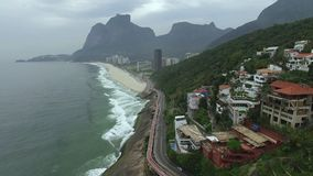 Highway by the sea. Wonderful road and bike path. Bicycle and road track and next to the blue sea in the city of Rio de Janeiro. Tim Maia bike path on Niemeyer stock video
