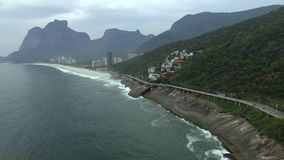 Highway by the sea. Wonderful road and bike path. Bicycle and road track and next to the blue sea in the city of Rio de Janeiro. Tim Maia bike path on Niemeyer stock footage