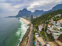 Highway by the sea. Wonderful road and bike path. Bicycle and road track and next to the blue sea in the city of Rio de Janeiro. Tim Maia bike path on Niemeyer stock photography