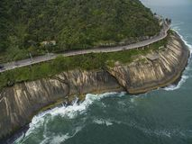 Highway by the sea. Wonderful road and bike path. Bicycle and road track and next to the blue sea in the city of Rio de Janeiro. Tim Maia bike path on Niemeyer royalty free stock image