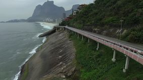 Highway by the sea. Wonderful road and bike path. Bicycle and road track and next to the blue sea in the city of Rio de Janeiro. Tim Maia bike path on Niemeyer stock video footage