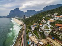 Highway by the sea. Wonderful road and bike path. Bicycle and road track and next to the blue sea in the city of Rio de Janeiro. Tim Maia bike path on Niemeyer stock photo