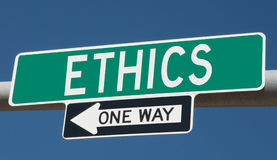 Highway sign with ETHICS and ONE WAY Stock Image