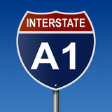 Highway sign for Interstate Route A1 in Alaska. A 3d rendering of a highway sign for Interstate Route A1 with blue sky stock illustration