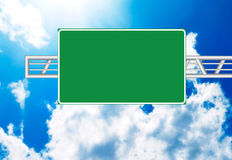 Highway sign. Over blue sky stock photos