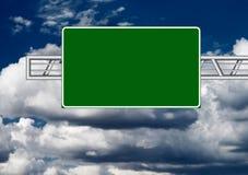 Highway sign. Over dark sky stock photos