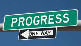 Highway sign with PROGRESS and ONE WAY Stock Photography