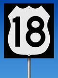 Highway sign for Route 18. A 3d rendering of a highway sign for Route 18 with blue sky Royalty Free Stock Images