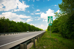 The highway sign on the side of the road Royalty Free Stock Photo