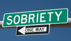 Highway sign with SOBRIETY and ONE WAY Stock Photos