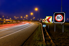 Highway Signs. The warning signs on a motorway junction at night stock image