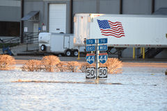 Highway Signs Under Flood Waters in Missouri Stock Photography