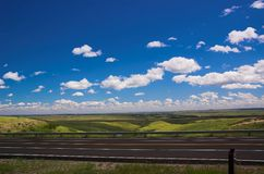 Highway and Sky. Blue sky and open highway stock image