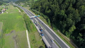 Highway from the sky. Aerial shoot of a highway in a valley near a small village stock video