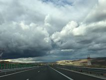 Highway and sky with clouds. A free highway in a sunny day with sky and clouds in background stock photography