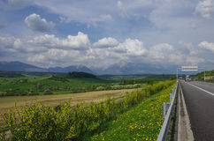 Highway in Slovakia. Meadows and High Tatras peaks panorama on b royalty free stock image