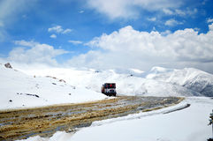 Highway through snow capped mighty Himalayas Stock Image