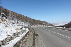 Highway among snow mountain , Belokurikha,  Altai, Russia Royalty Free Stock Images
